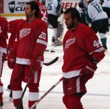 Robert Lang and Todd Bertuzzi watch their teammates during pregame warmups.