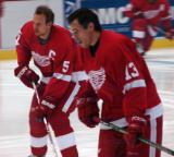 Nicklas Lidstrom and Pavel Datsyuk skate in on goal during pregame warmups.