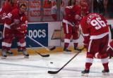 Henrik Zetterberg and Tomas Holmstrom pass the puck back and forth during pregame warmups.