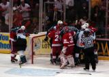 The Red Wings and Sharks get into a scrum at Detroit's end of the ice.