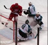 Kyle Calder crashes the net, attempting to knock the puck past San Jose goalie Evgeni Nabokov.
