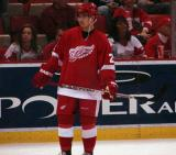 Jiri Hudler stands along the far boards duing pregame warmups.