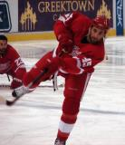 Kyle Quincey leans into a shot during pregame warmups.