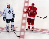 Tomas Holmstrom gets set for the opening faceoff of a preseason game against Toronto, standing aside Alexei Ponikarovski of the Maple Leafs.