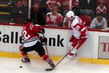 Brian Rafalski fights for the puck along the boards with Chicago's Rene Bourque.