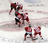 Henrik Zetterberg takes a draw against former Red Wing Robert Lang, with Tomas Holmstrom and Pavel Datsyuk on his wings.