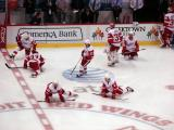 A group of Red Wings stretches near center ice during pre-game warmups.