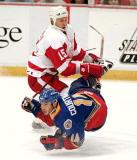 Dmitri Mironov lays a big hit on St. Louis' Geoff Courtnall.