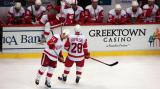 The Detroit bench during a stop in play, with Henrik Zetterberg jumping onto the ice to join Dan Cleary and Brian Rafalski.
