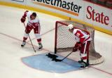 Kris Draper and Kirk Maltby clear pucks from the crease during pre-game warmups.