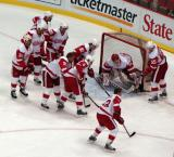 A group of Red Wings mob around Chris Osgood in the goal during pre-game warmups.