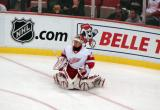 Chris Osgood stretches in the corner during pre-game warmups.