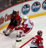 Pavel Datsyuk goes behind the Chicago net, chasing after the puck with Andrei Zyuzin.