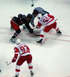 Valtteri Filppula takes a faceoff against Columbus' Manny Malhotra with Johan Franzen on his wing.