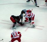 Henrik Zetterberg takes a faceoff against Columbus with Pavel Datsyuk on his wing.