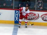 Henrik Zetterberg stands at the blue line during pre-game warmups waiting for a puck.