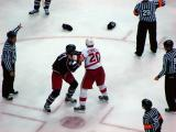 Aaron Downey and Columbus' Jared Boll tangle while the officials keep their teammates from interfering.