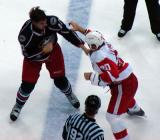 Aaron Downey and Columbus' Jared Boll throw punches as their long fight continues.