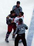 Aaron Downey and Columbus' Jared Boll grab ahold of each other as their long fight winds down and is broken up.