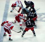 Kris Draper takes a faceoff against Columbus' Manny Malhotra with Dan Cleary and Kirk Maltby on his wings.
