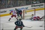 Chris Osgood makes a series of saves against the Columbus Blue Jackets, including a diving goal-line stop on Rick Nash.