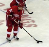 Tomas Kopecky plays with a puck near center ice during pre-game warmups.