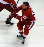 Kris Draper passes the puck out from the slot during pre-game warmups.