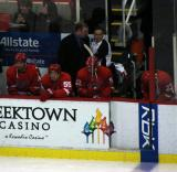 Andreas Lilja, Niklas Kronwall, Jonathan Ericsson and Brad Stuart sit on the defensive end of the Detroit bench before the start of the game.