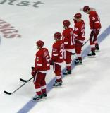 "Nicklas Lidstrom, Kris Draper, Dallas Drake, Brian Rafalski and Kirk Maltby stand at the blue line for the singing of ""The Star-Spangled Banner."""