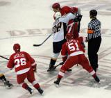 Valtteri Filppula loses a faceoff to Nashville's Vernon Fiddler while flanked by Jiri Hudler and Mikael Samuelsson.