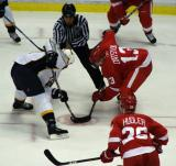 Pavel Datsyuk takes a faceoff with Jiri Hudler on his wing.
