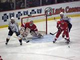 Dominik Hasek follows the puck, with Nicklas Lidstrom defending the top of the crease.