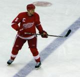 Nicklas Lidstrom straddles the blue line, following the puck.