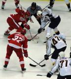 Johan Franzen takes a faceoff with Nashville's Jason Arnott, with Mikael Samuelsson on his wing.