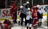 The Red Wings and Predators come together after Dominik Hasek is knocked down behind the Detroit net.