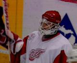 Chris Osgood stands in goal during a stoppage of play.