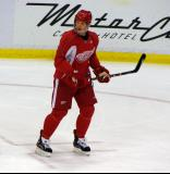 Dan Cleary skates through the left faceoff circle while watching his teammates during practice.