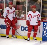 Tomas Kopecky and Aaron Downey stand along the boards during practice.