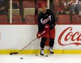 Chris Chelios passes the puck from the far boards during practice.