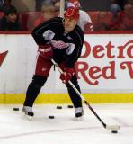 Brett Lebda passes the puck from along the boards during practice.