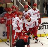Jiri Hudler, Dan Cleary, Dallas Drake, Darren McCarty, Kirk Maltby and Aaron Downey stand in a group during practice.