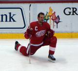 Nicklas Lidstrom stretches during pre-game warmups.