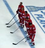 "Tomas Holmstrom, Brian Rafalski, Henrik Zetterberg, Nicklas Lidstrom and Pavel Datsyuk stand at the blue line for the singing of ""The Star-Spangled Banner."""