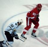 Johan Franzen moves through the neutral zone, shadowed by Dallas' Mike Ribeiro.