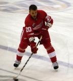Aaron Downey stickhandles across the blue line during pre-game warmups.