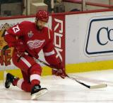 Brad Stuart stretches along the boards during pre-game warmups.