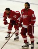 Kris Draper and Henrik Zetterberg stand in the neutral zone during pre-game warmups.