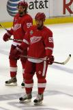 Niklas Kronwall and Johan Franzen stand inside the blue line during pre-game warmups.
