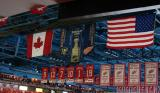 The NHL's Stanley Cup Final banners hanging between the Canadian and American flags.