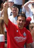 With his eyes closed, Chris Chelios raises his index finger to the fans at the 2008 Stanley Cup parade.